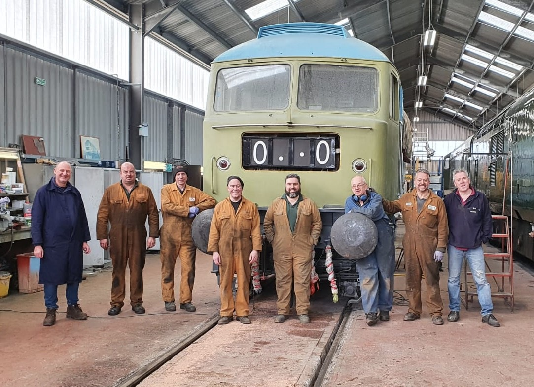 Members of the Brush Type 4 Fund pose with 47105 after it was successfully started on 21 March 2020