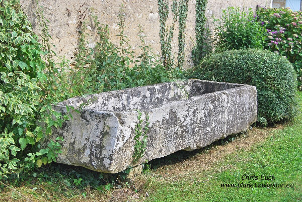 large stone trough that was once situated next to a well.France