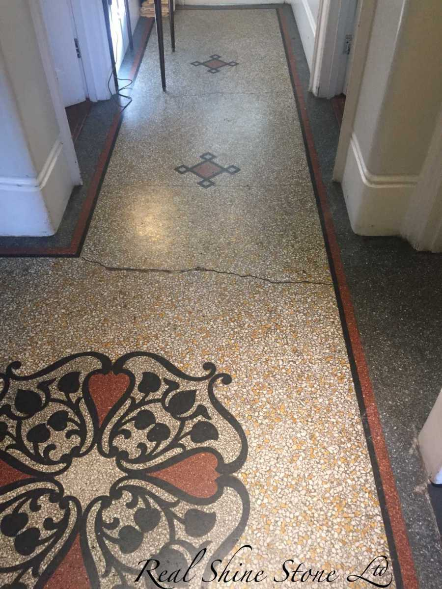 Terrazzo floor before restoration and crack repairs