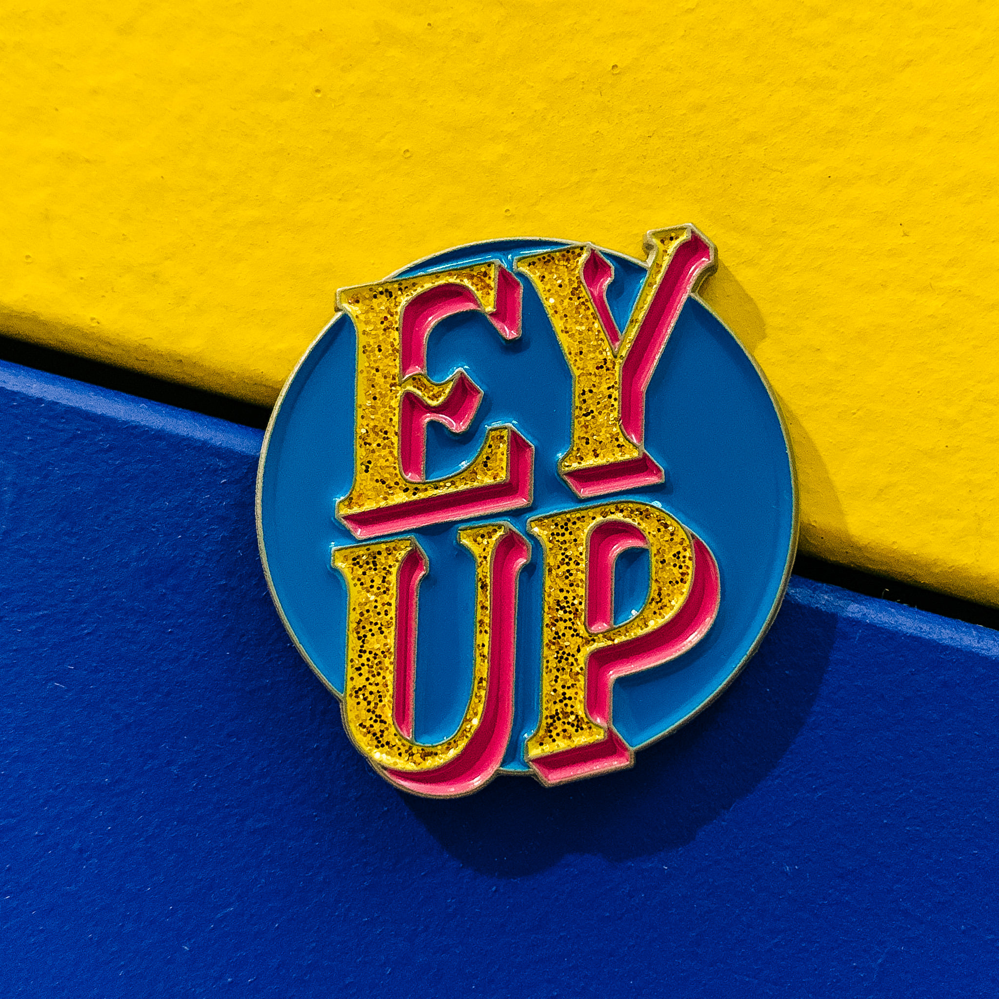 'EY UP' enamel pin ' Savage Noodle' colourway.