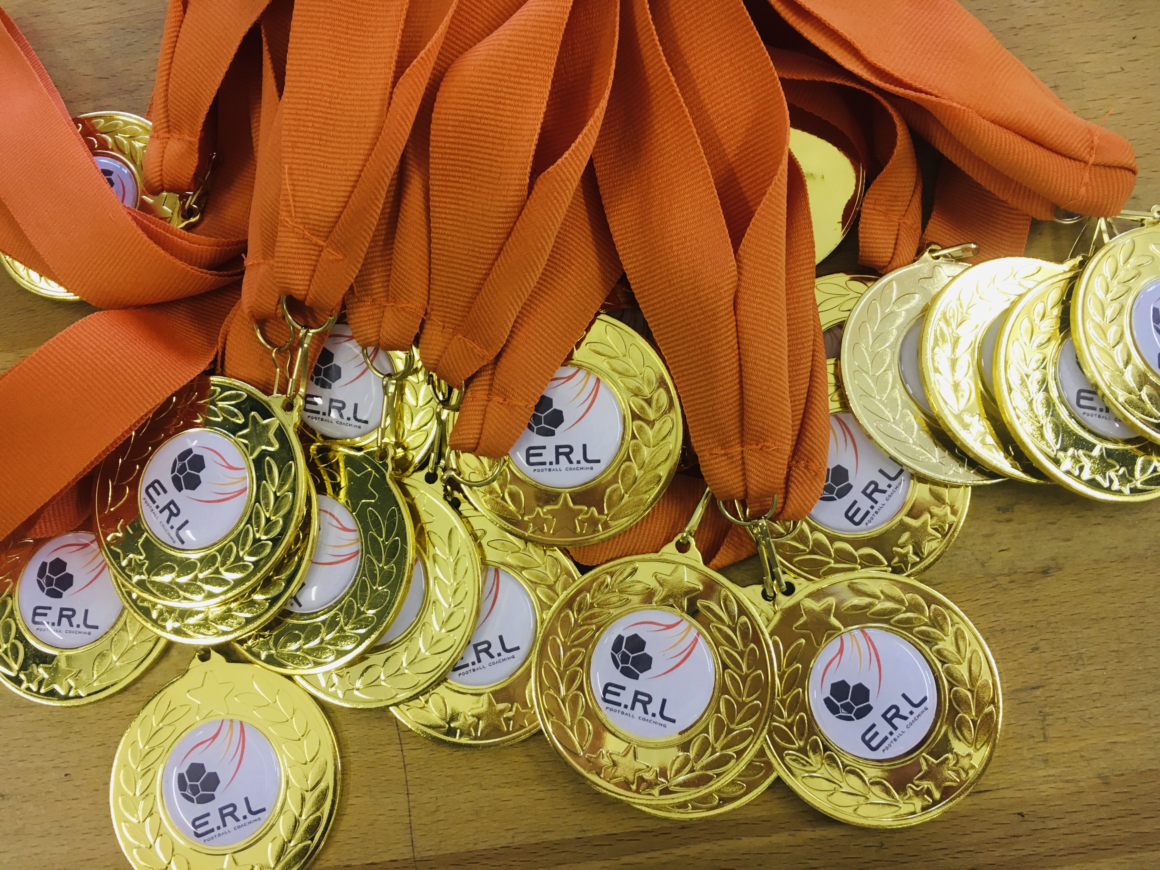 Medals with bespoke club centre and ribbon