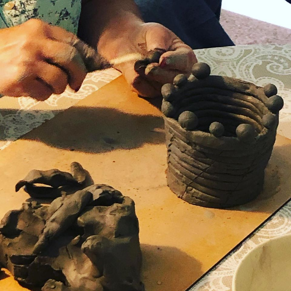 Clay coil pot being made in a clay workshop run by Akers of Art