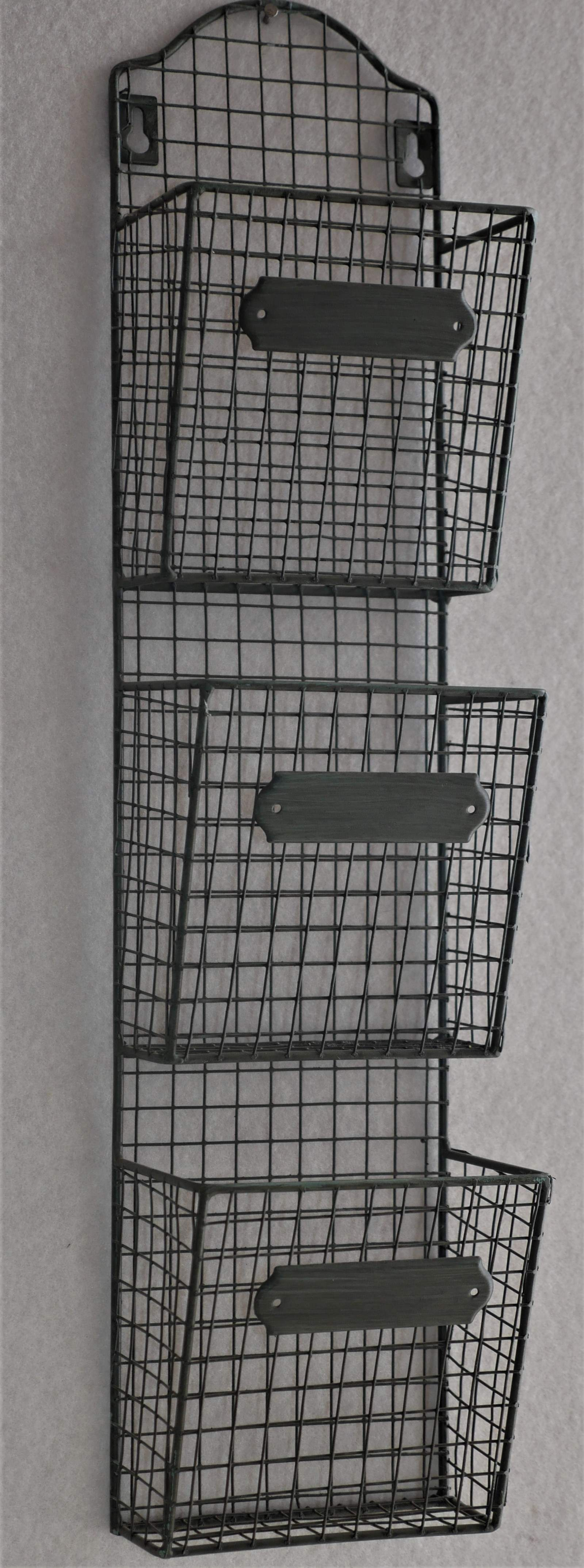 Wire Wall rack with three pockets for storage.