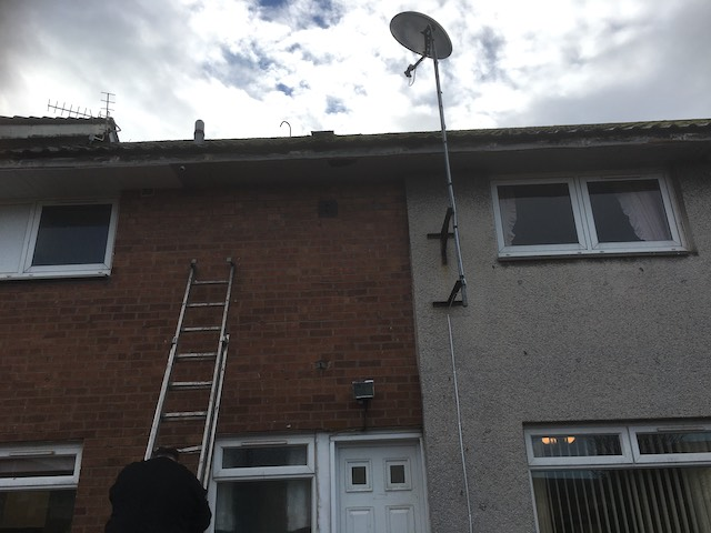 Old guttering and fascias have been removed from the roofline of these 2-storey houses