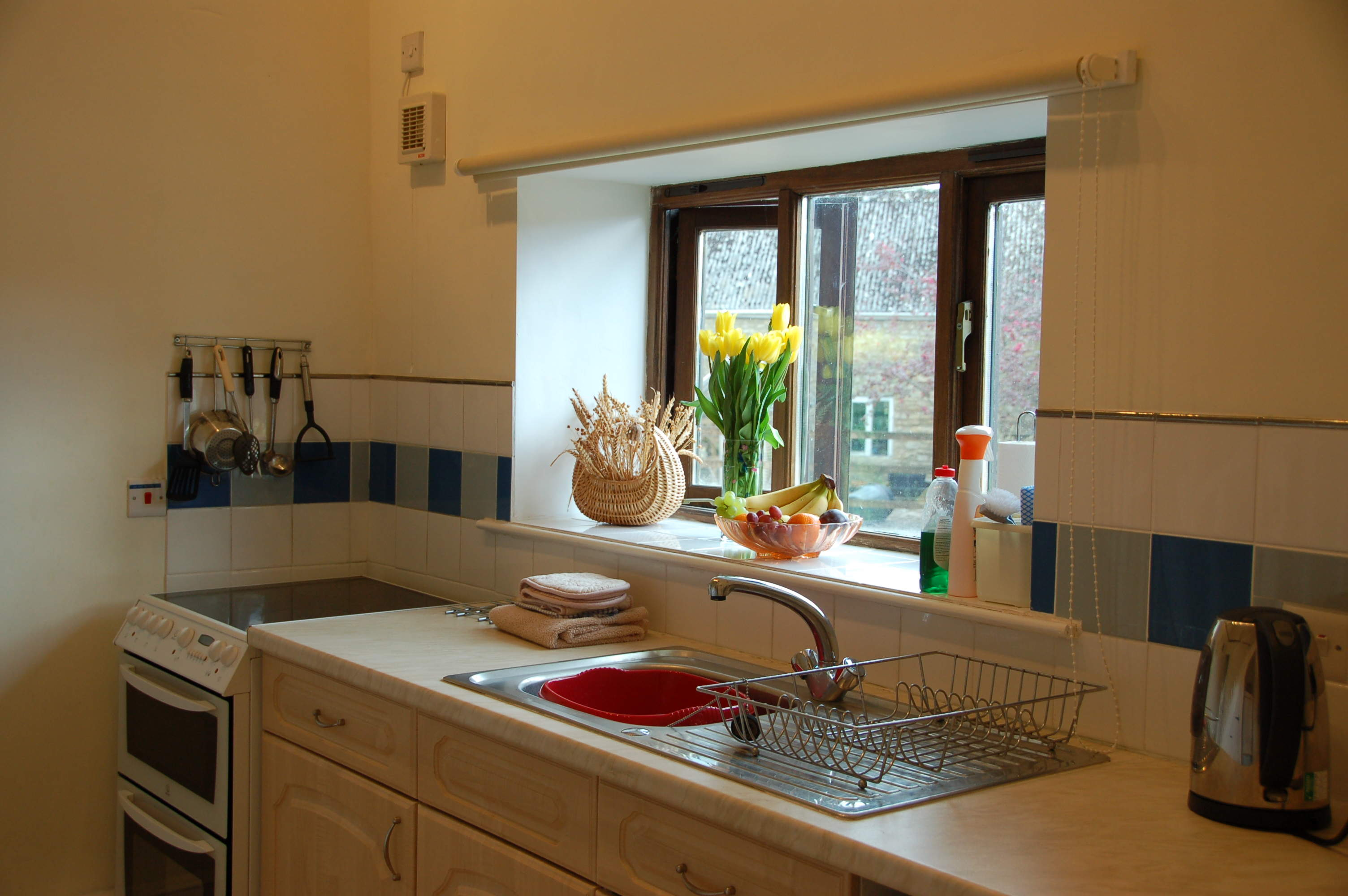 fully fitted kitchen with full size oven with ceramic hob, microwave, full size fridge freezer