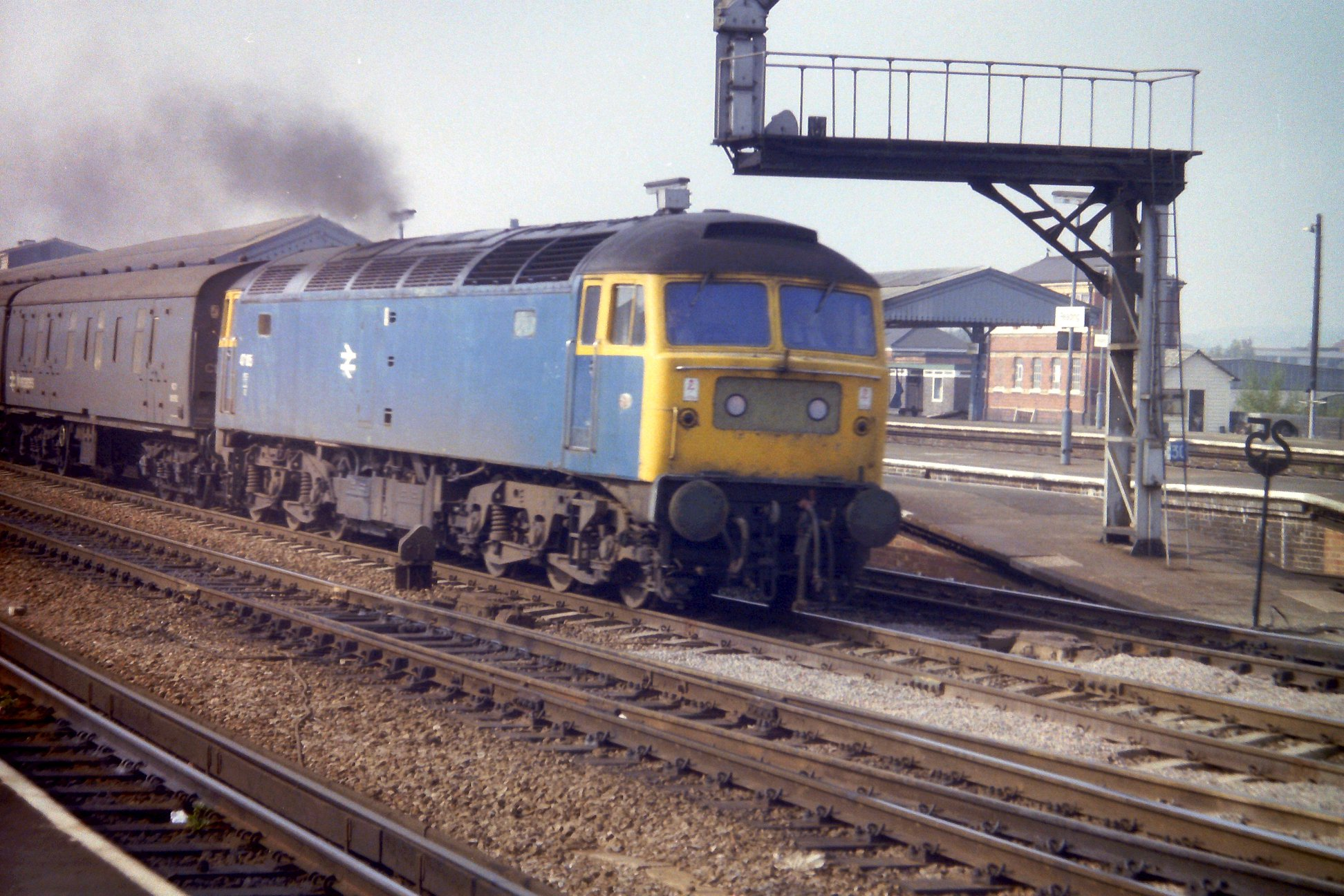 47105 passes through Reading with a van train for Paddington 26/04/83  (D Lamy)