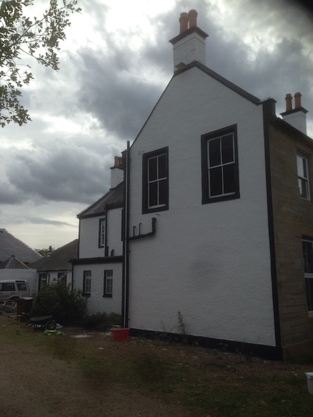 Gable end of a large house in Dalmellington, Ayrshire, with its new fresh coat of white paint