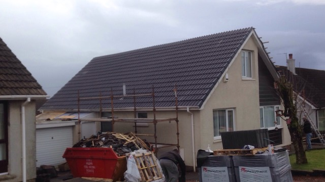 Job done! All the new roof tiles are in place and ready for another 30 years of the Scottish weather