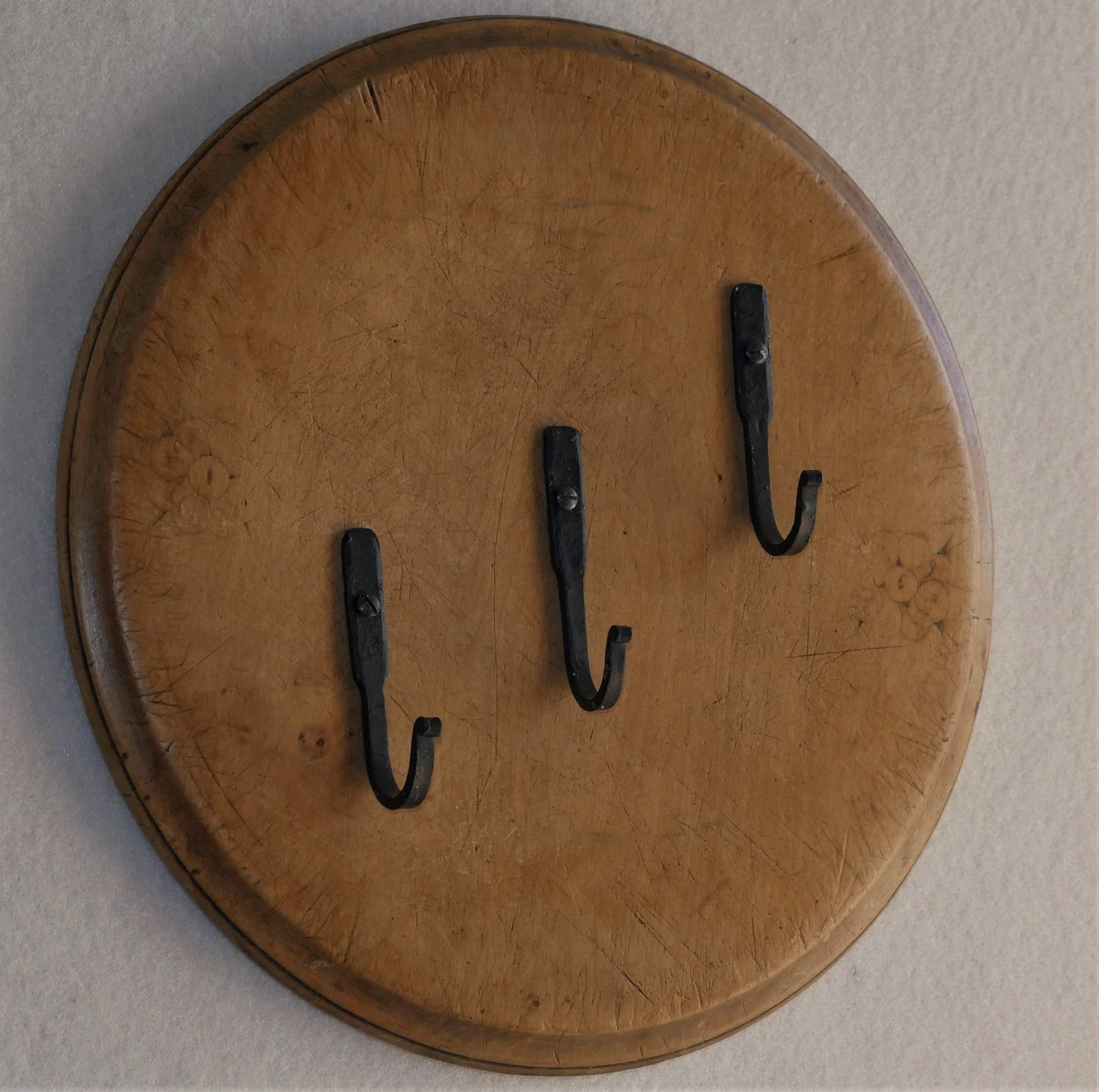 Vintage breadboard with hand forged hooks.