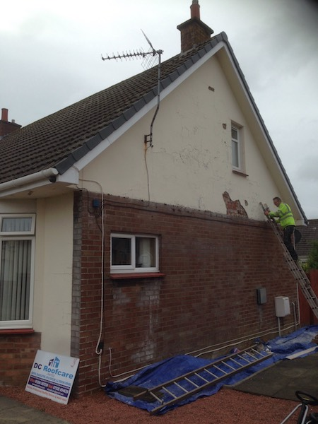 The plaster and paint finish on the gable end of this Ayr house was cracked and peeling