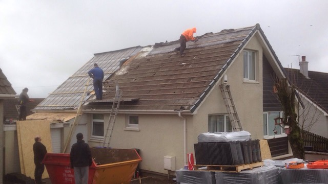 DC Roofcare removing old tiles and felting from the roof of a chalet style bungalow in Stewarton, Ayrshire