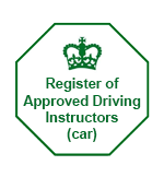 Green on white octagonal badge of the register of DVSA Approved Driving Instructors