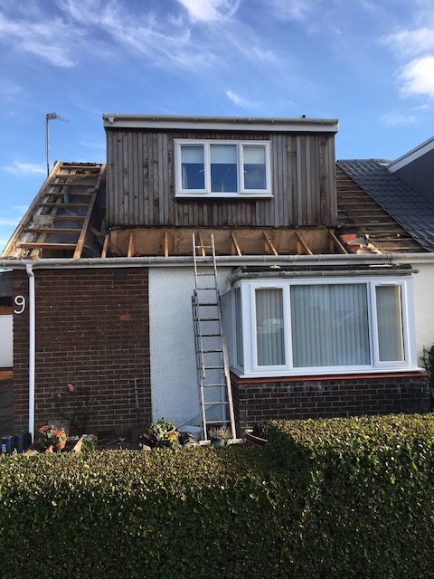 Old roof stripped back on a bungalow with dormer window