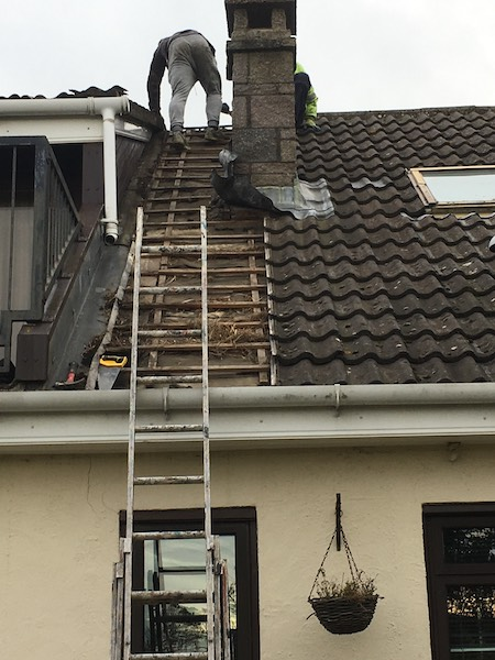 DC Roofcare team on a roof in Troon, Ayrshire, undertaking repairs