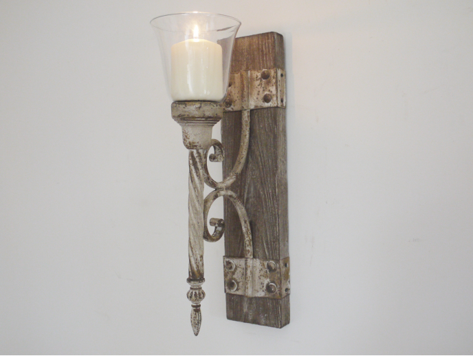 Wood and metal wall candle holder.