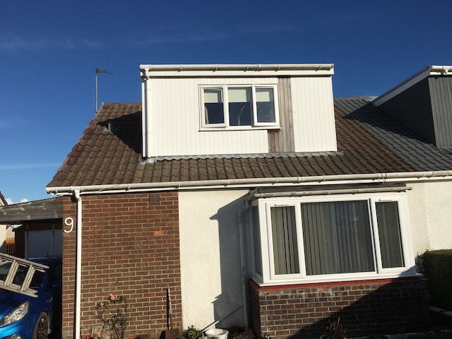 Old roof on a bungalow with dormer window, roof to be replaced and dormer window surround painted