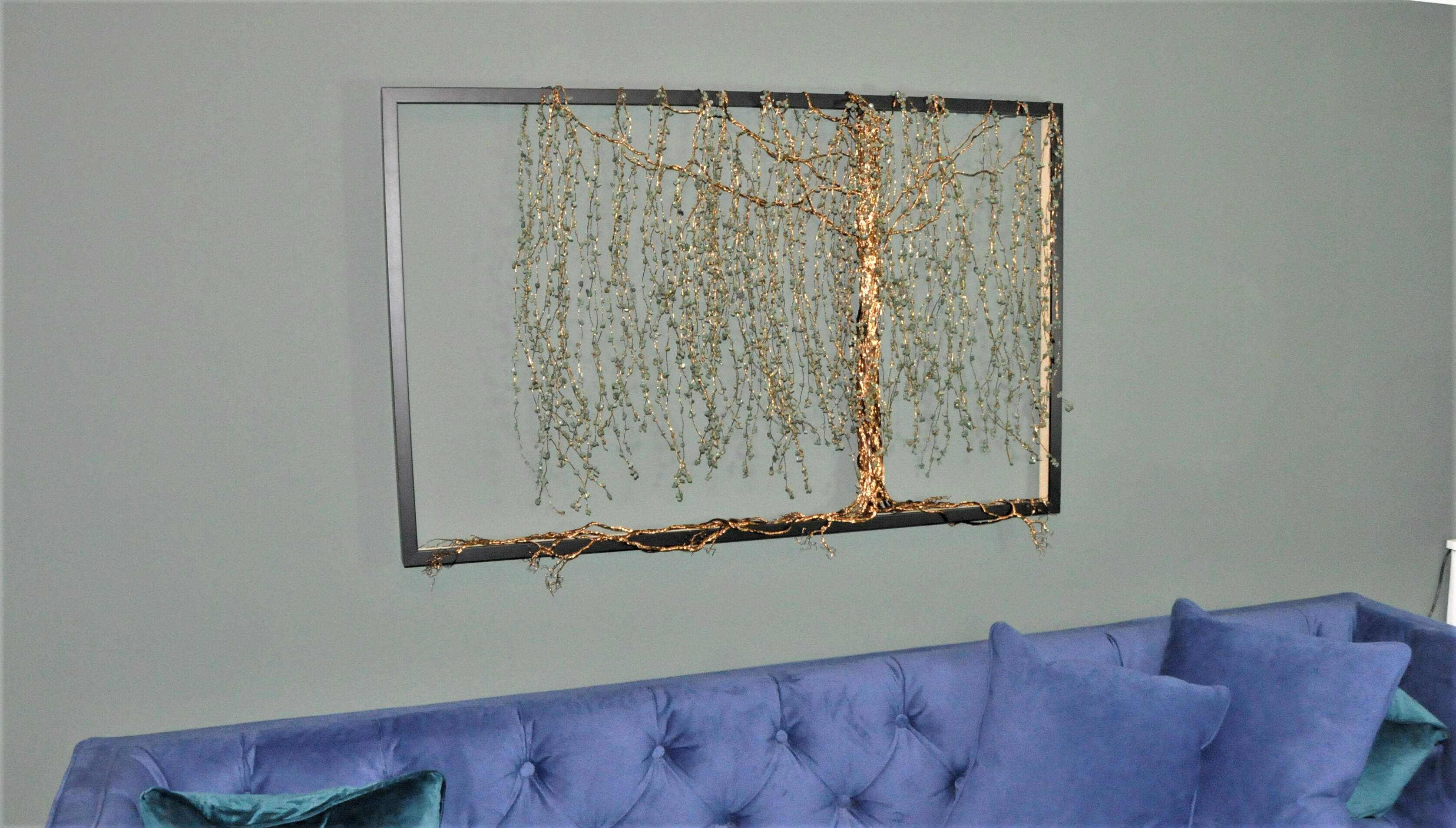 Sculpture using antique bronze and aventurine to create a willow tree cascading from the frame