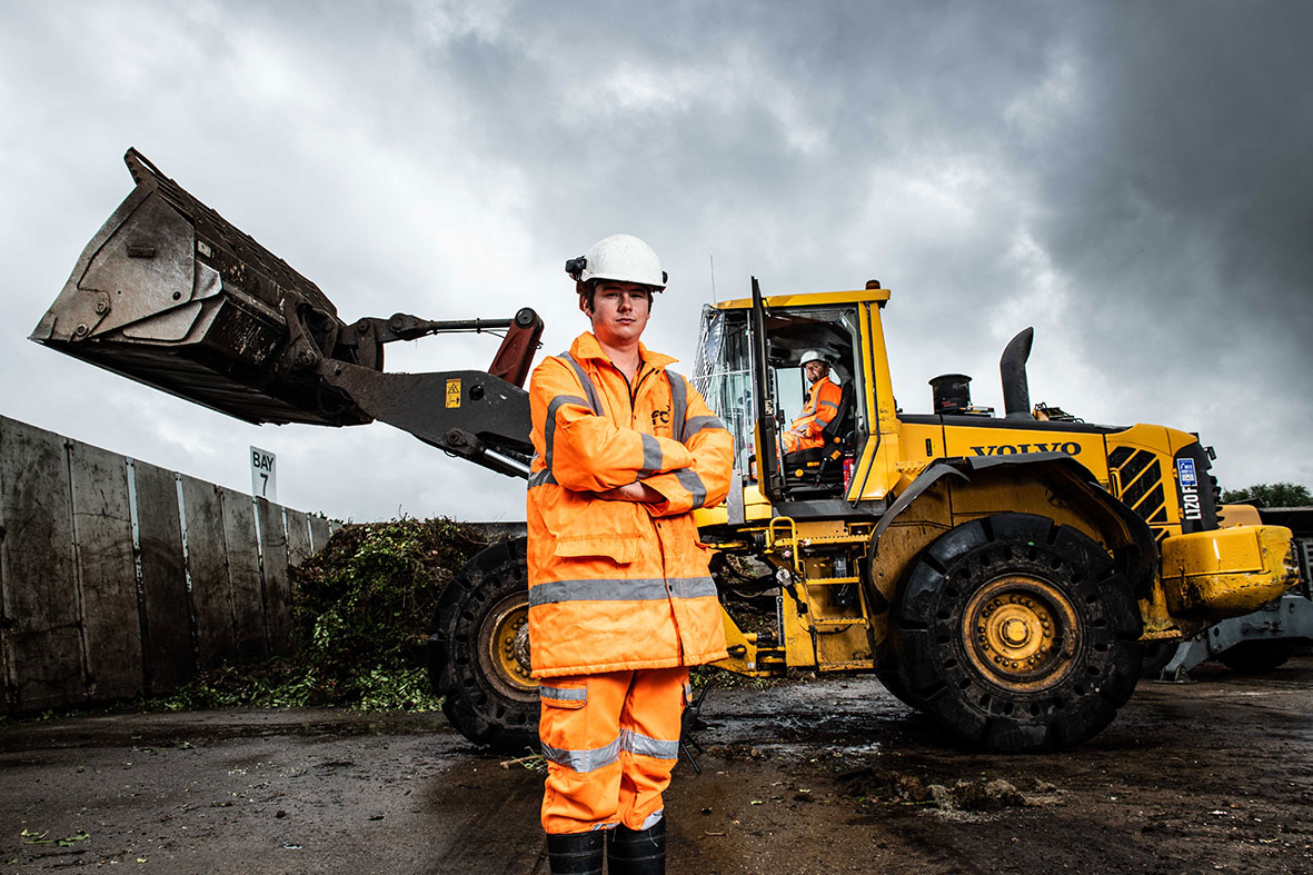 Industrial portrait shoot of a manager at a recycling plant, South East England