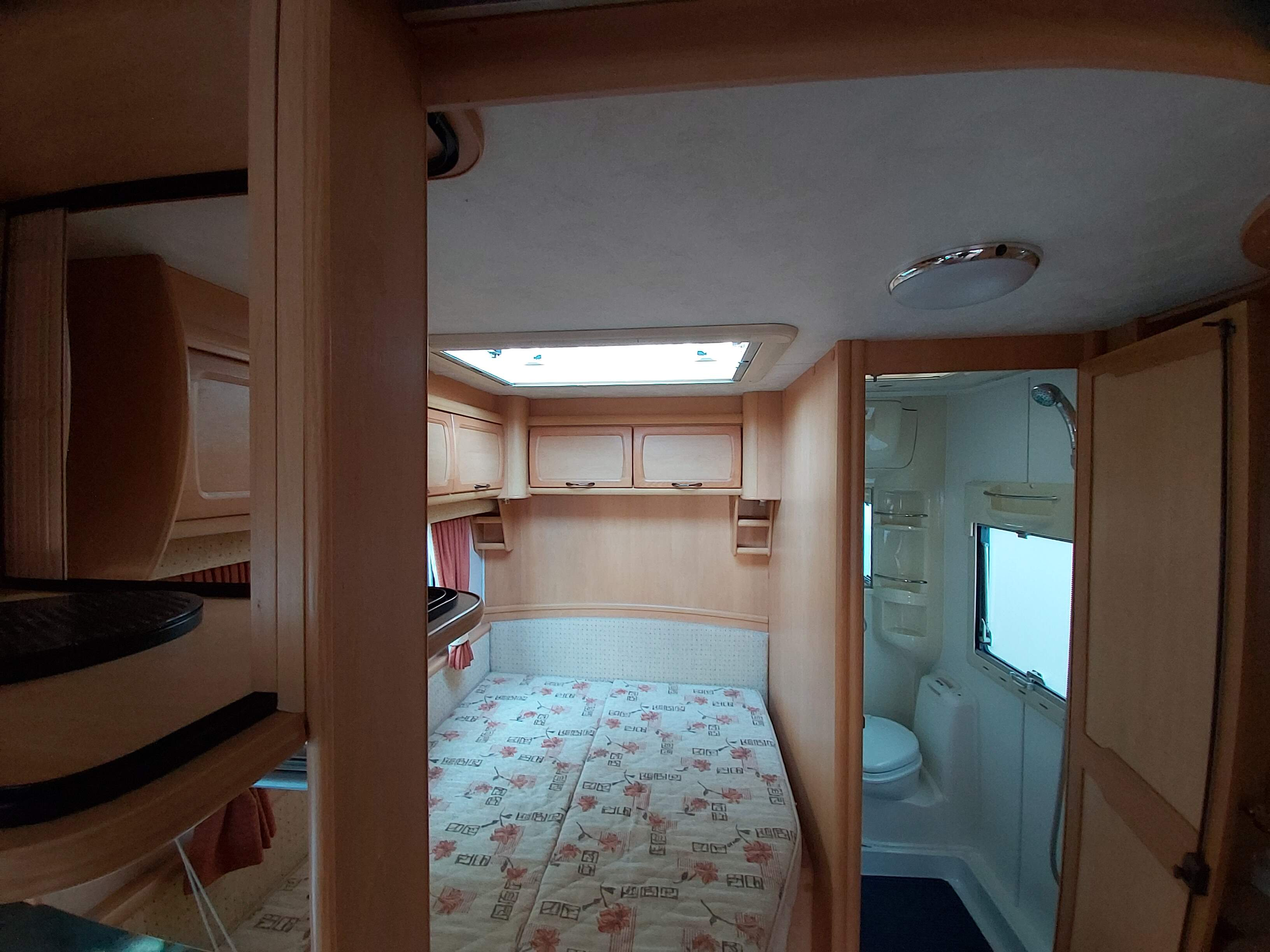 2004 Elddis Odyssey 534 4 Berth Fixed Bed Caravan with Motor Mover