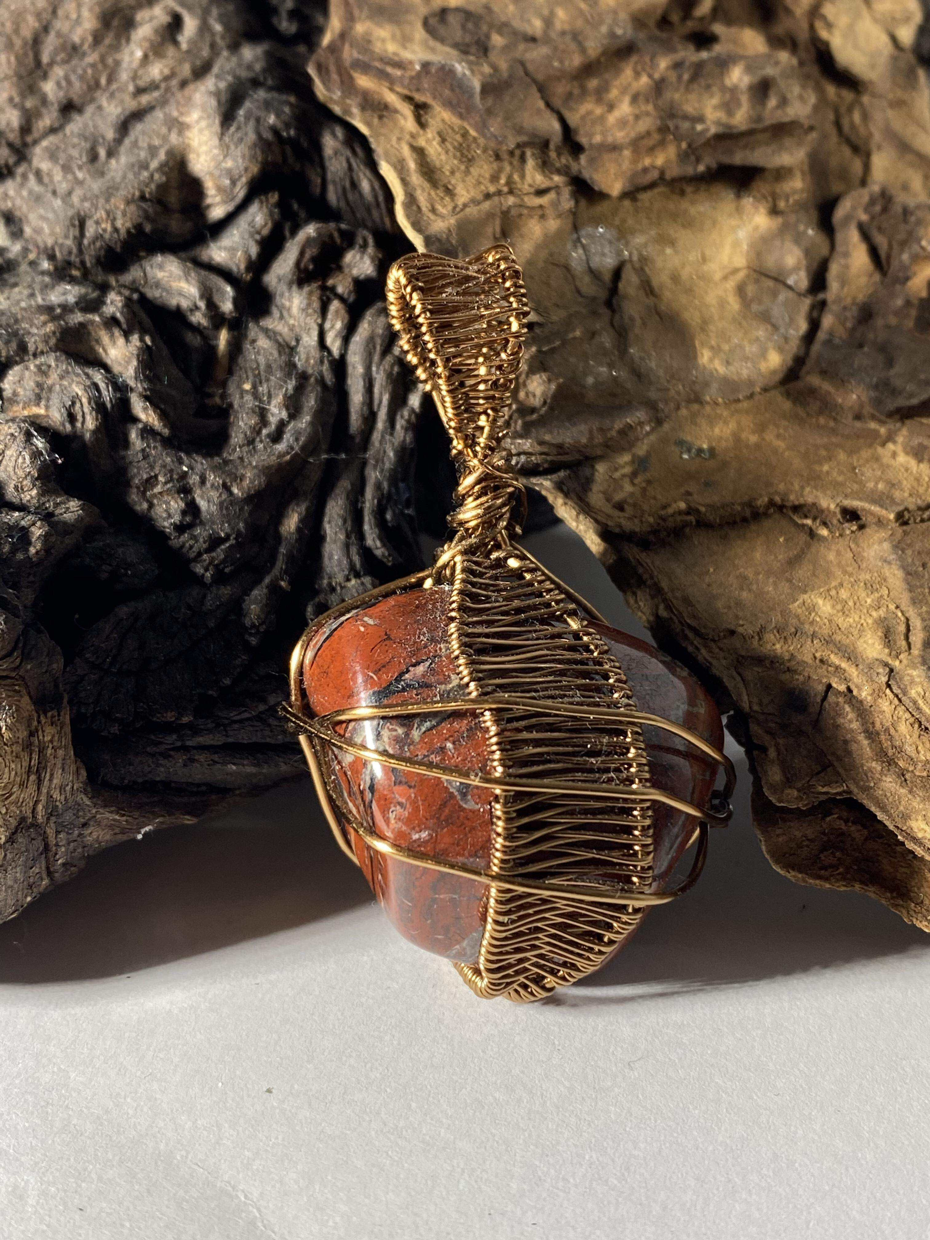 Red agate and antique bronze pendant