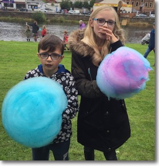 Children enjoying FunkyFloss from Wee Sweetie Confectionery Company in an outdoor setting