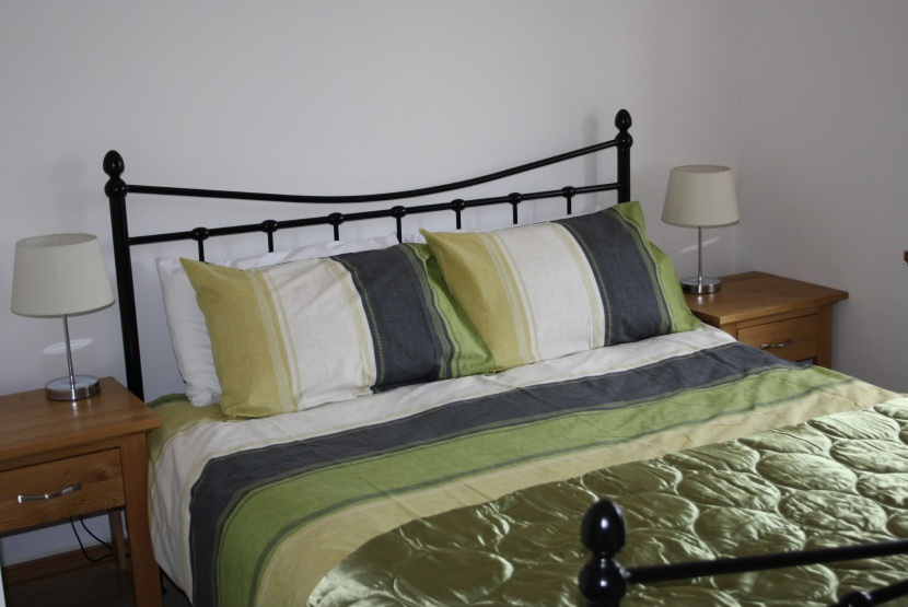One of the bedrooms at Drumfad Barn self-catering holiday cottage in Port William, south-west Scotland