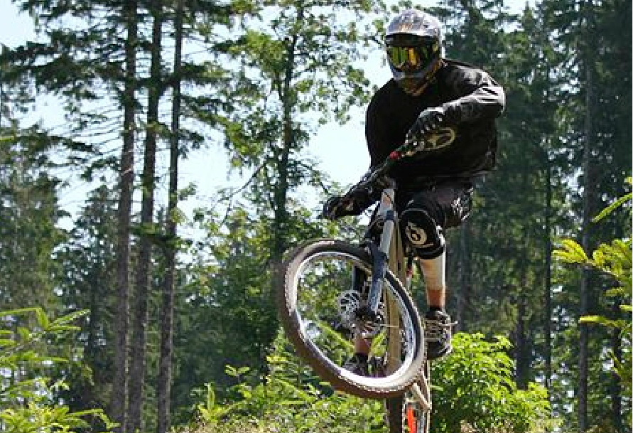 Mountain biker flying through the air