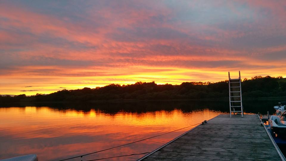 A beautiful sunset over Auchenreoch Loch from the decking at The Inn on the Loch