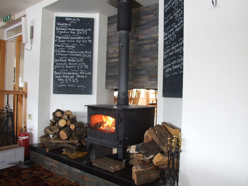 Cosy woodburning stove in the Inn on the Loch restaurant