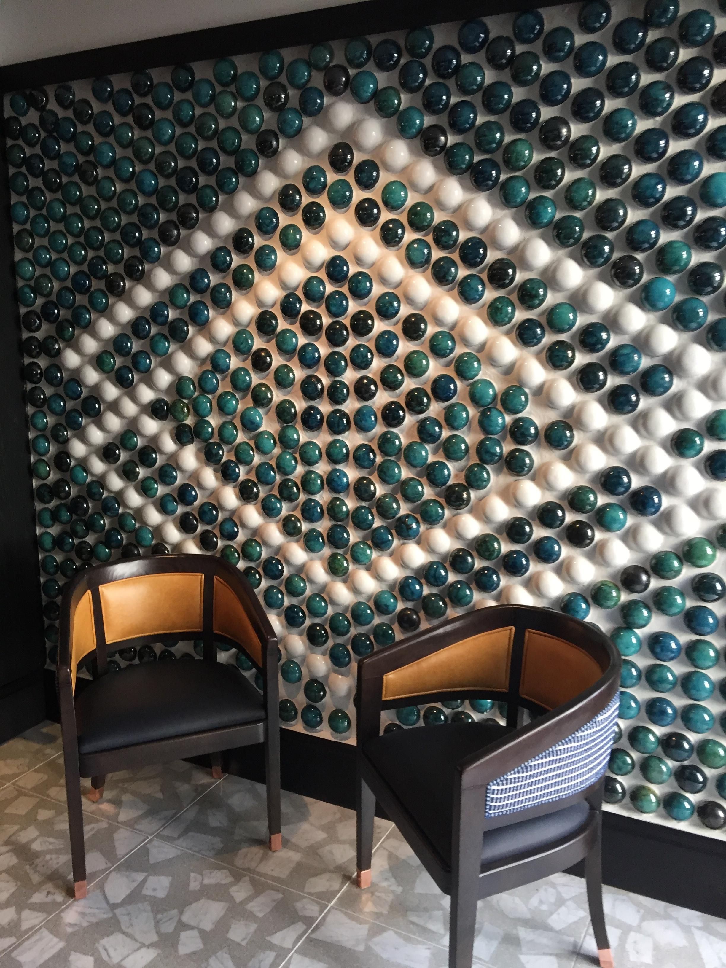 This gorgeous, bespoke, handmade,pebble style of architectural wall tile, unique, was designed by Guy Mitchell for the Margot,Covent Garden, London restaurant,By Dream Tiles Bicester , Oxfordshire. Call 01869357777