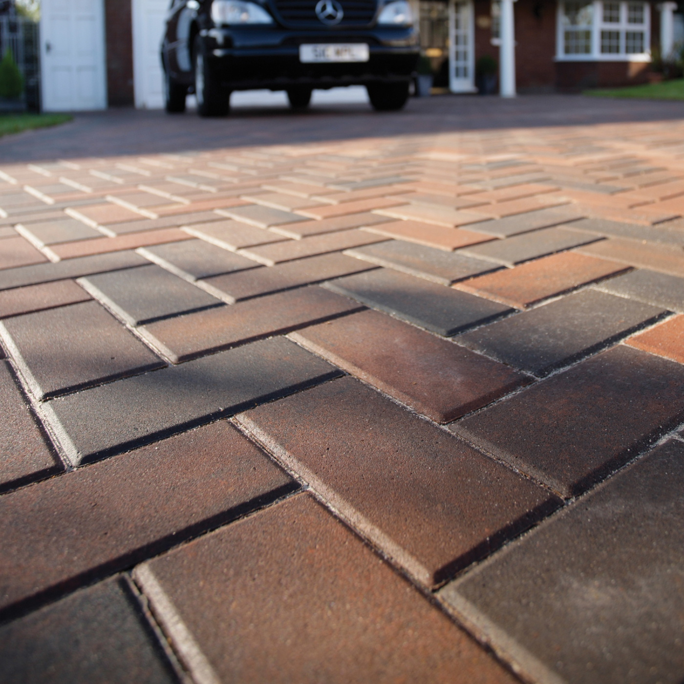 A close-up view of a terracotta coloured block paved driveway in West London