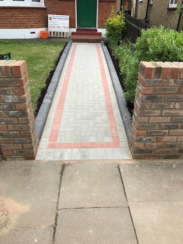 New block pave front path to home in Ealing with patterned coloured blocks