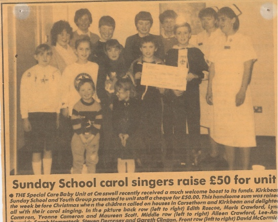 Newspaper cutting about Kirkbean Sunday School carol singers raising money for Cresswell Special Care Baby Unit, Dumfries