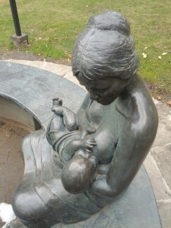 The Endless Bench sculpture showing a breastfeeding mother