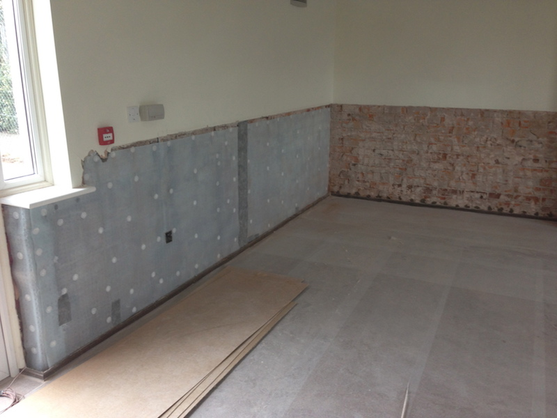 Brick walls and flooring being treated for damp by Ryedale Remedials of Dumfries