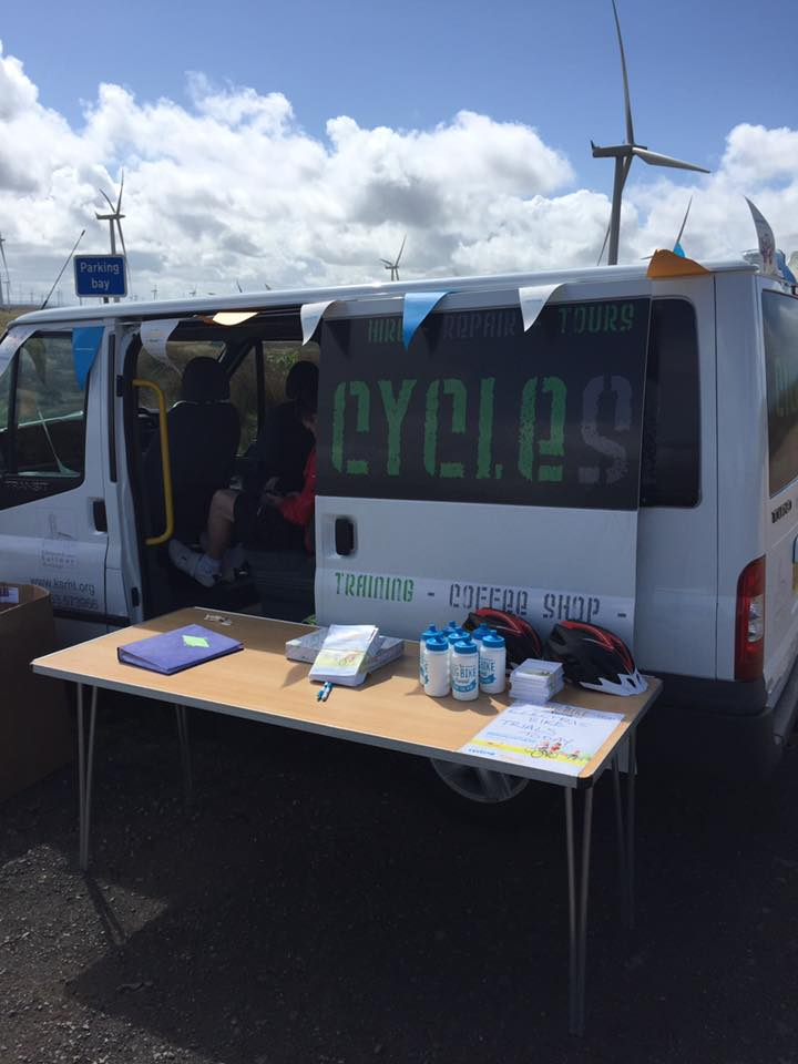 The CycleStation minibus and table ready to sign up potential cyclists