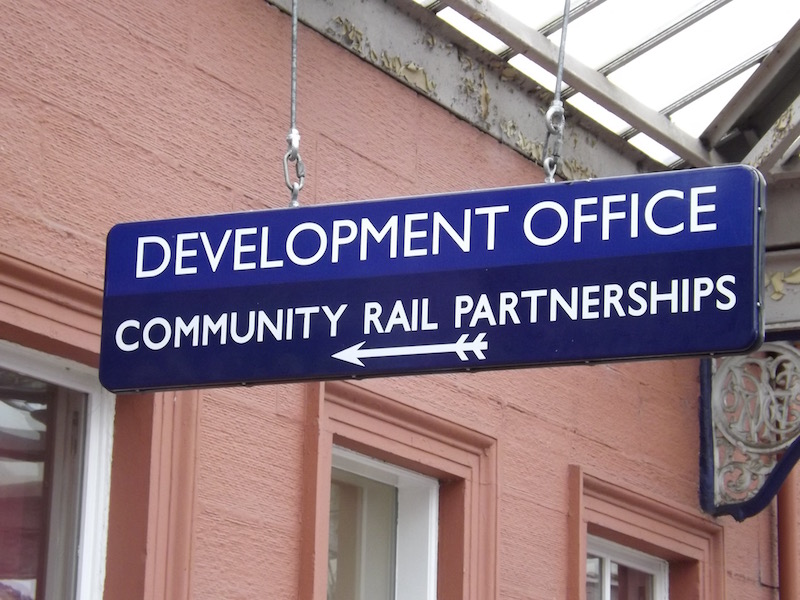 Sign pointing to the Development Office for Community Rail Partnerships within Kilmarnock Station