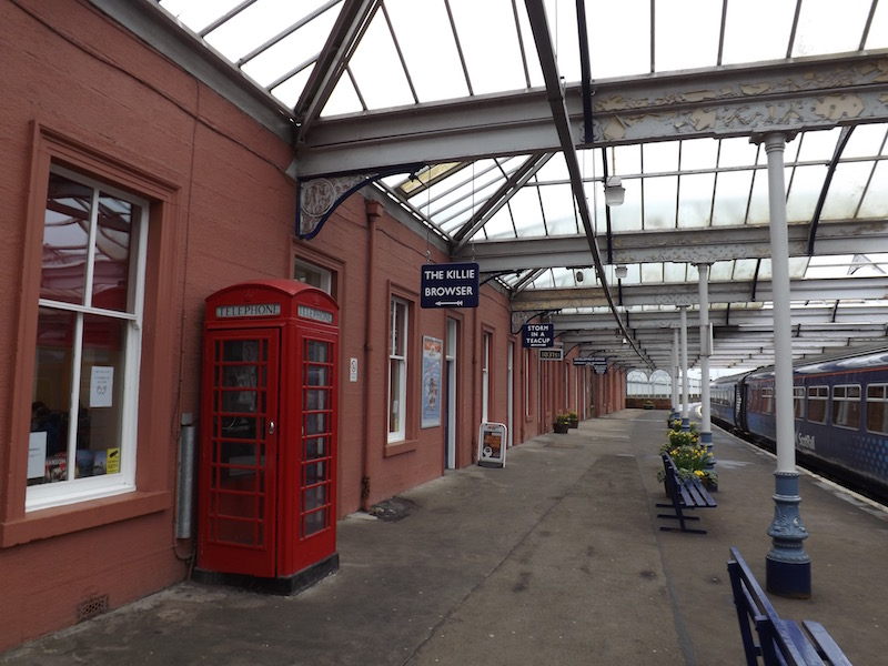 Old red telephone box on one of the platforms at Kilmarnock Station