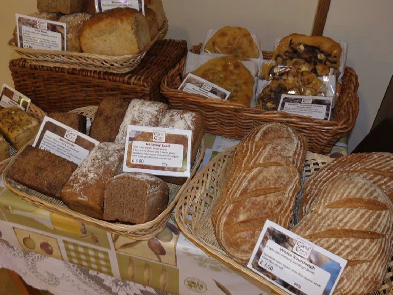 Baskets full of breads, rolls and cakes including gluten free items