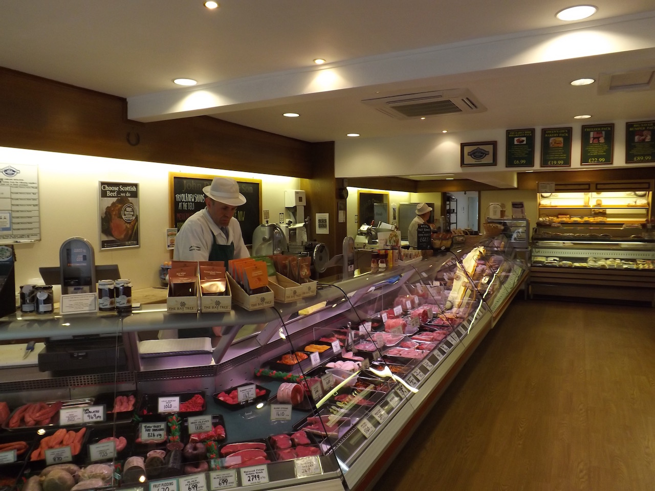 Interior shot showing the new refrigerated counters and a grand display of butcher meat and deli produce