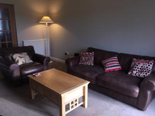 Kilfillan Cottage lounge with its comfy leather suite