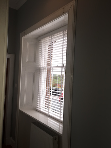 Newly painted hallway and new venetian blinds