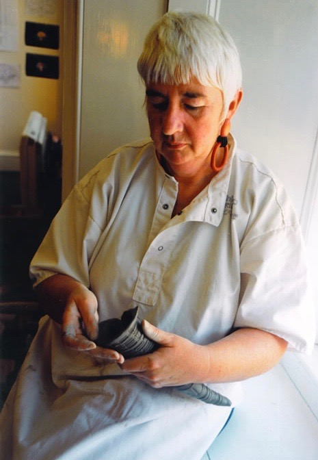 Winifred Wright at work on a piece of pottery