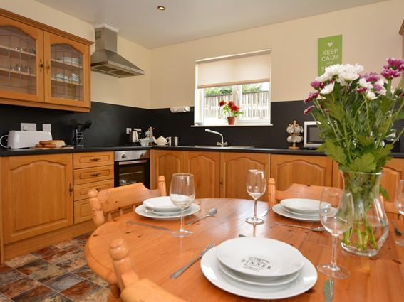 The large dining kitchen within Cairnsmore Cottage holiday accommodation for a family of six