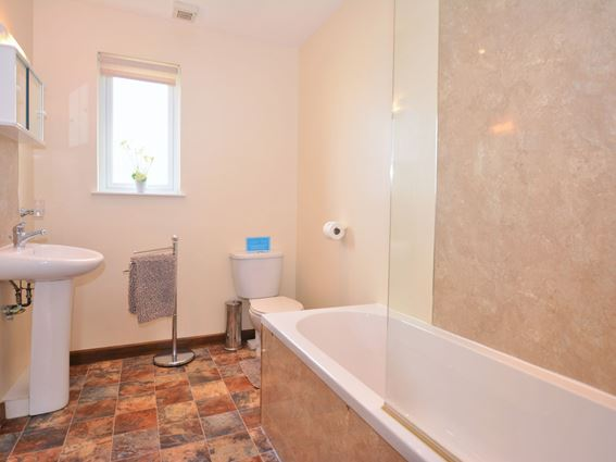The bathroom at Creeview Cottage holiday accommodation near Newton Stewart, south west Scotland, has a shower over the bath