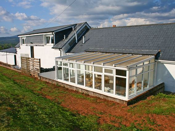 Carty Holiday Cottage with its dining room conservatory