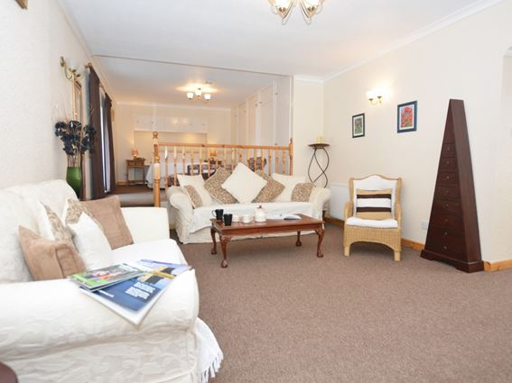 The open plan living room and bedroom area of Carty Holiday Cottage near Newton Stewart
