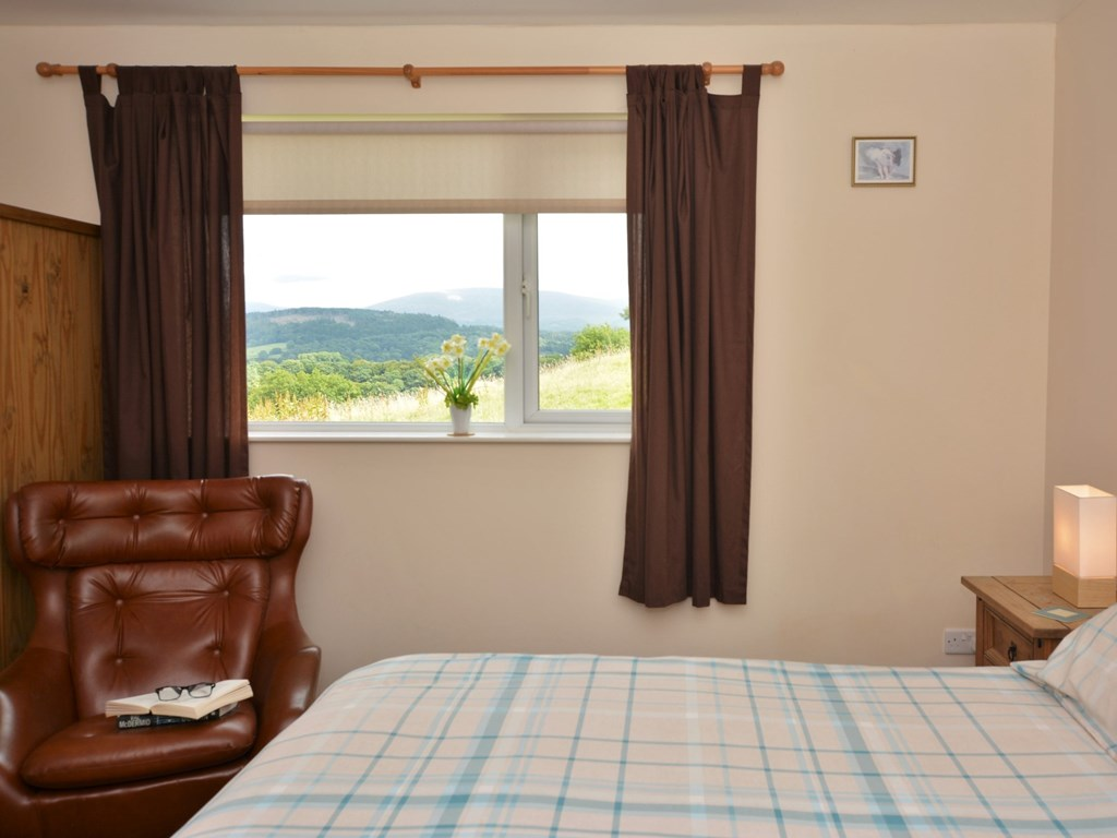 The view from the double bedroom at Cairnsmore Cottage looks out towards the Galloway Hills and Cairnsmore