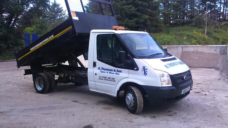 A van tipping its load of aggregates