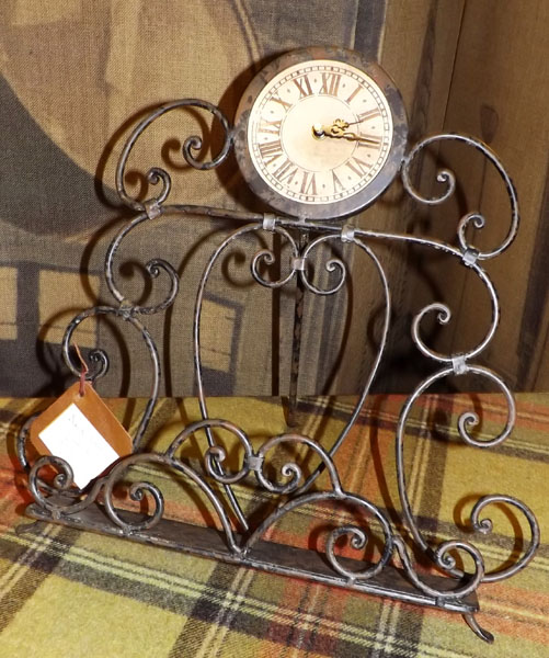 Wrought iron book stand with integrated clock